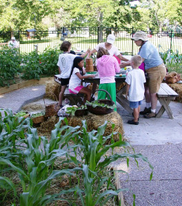 "Members of Des Fleurs hold an annual ""Gardeneering Camp"" for children."